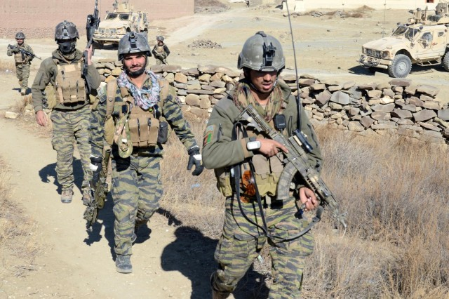 Special squad members assigned to the Paktika vllage response unit clear Oazai village in Sar Houzah district, Paktika Province, Afghanistan, Jan. 5, 2014. Afghan Local Police secured the ridge lines surrounding the village during the operation.