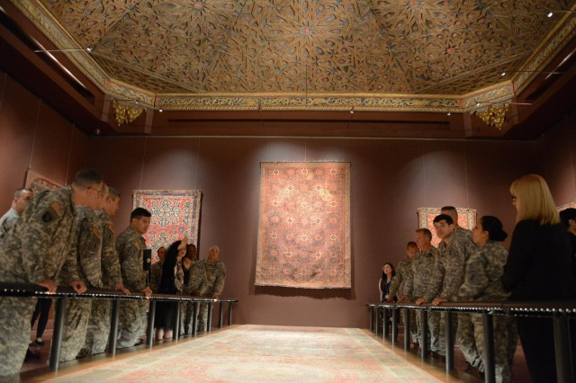 A group of Soldiers with the 353d Civil Affairs Command, look up at The Simonetti Spanish ceiling within The Metropolitan Museum of Art Islamic Art exhibit, Nov. 17, 2013, in New York City. The ceiling originated in Spain and was made during the 16th century.