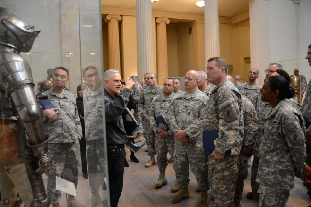 Hermes Knauer, a armorer with The Metropolitan Museum of Art in New York City, talks to Soldiers with the 353d Civil Affairs Command about the evolution of armor during the medieval times during the unit's visit to the museum, Nov. 17, 2013.