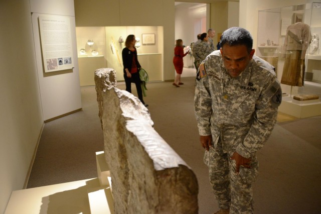 Maj. Carlstein Lutchmedial, with the 353d Civil Affairs Command, reads the inscription on a Iranian limestone tablet during a visit to the Metropolitan Museum of Art, Nov. 17, 2013, in New York City. The tablet originated during the early 300 B.C. era, and is on display in Near Eastern Art exhibit inside the museum.