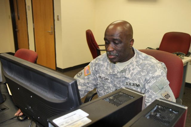 Master Sgt. Goliath Singletary finalizes documentation for an upcoming Advanced Leader Course at the 100th Training Division (OS) headquarters at Fort Knox, Ky. Singletary serves as the liaison between 4th Brigade, 100th Training Division and the Army Medical Department Noncommissioned Officer Academy, Joint Base San Antonio.