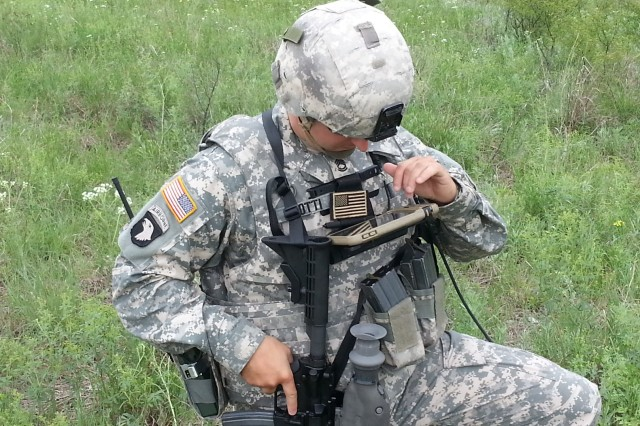 Sgt. 1st Class Justin Rotti, assigned to Fire Support Specialist (13F) Training and Doctrine Command (TRADOC) Capabilities Manager (TCM) Fires Cell, Fort Sill, Okla., tests the prototype Mobile Handheld Fires Application (MHFA) using a smartphone device. In the near future, forward observers will use the MHFA on the Nett Warrior device to digitally call for fires.