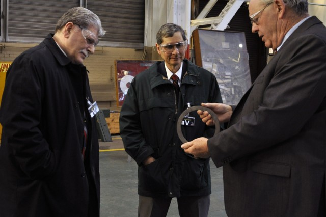 Deputy Commander Ed McCarthy, r, showing NYS VFW Commander Michael Pascal, l, and VFW District 3 Commander Eugene Ratigliano the type of minor component machining the arsenal does.