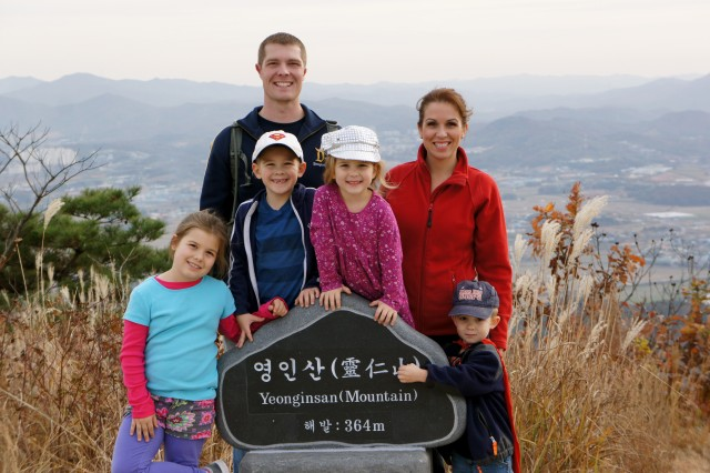 Army Sgt. Peter Adams, a unit public affairs representative with Headquarters and Headquarters Company, 602nd Aviation Support Battalion, 2nd Combat Aviation Brigade, 2nd Infantry Division, and a native of Kenai, Alaska, poses with his family as at Yeonginsan mountain after hiking together on Nov. 8, 2013.  Hobbies such as being hiking can improve a Soldier's resilience.