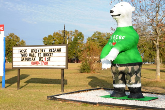 Sgt. Ted E. Bear puts on his Fort Rucker (Ala.) Community Spouses Club T-shirt to get ready for the upcoming Hollyday Bazaar. This year's bazaar will be Dec. 1, 2012, at Yano Hall, from 9 a.m. to 5 p.m.