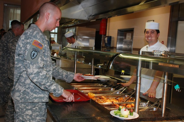 Great customer service starts with a smile for Soldiers eating lunch at U.S. Army Garrison Vicenza's dining facility.
