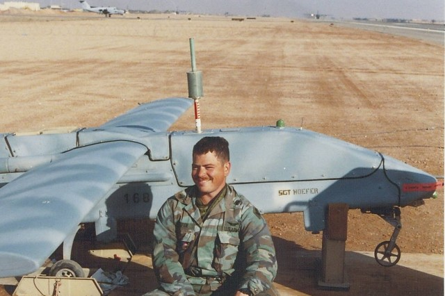 SGT Hoefer, of the 304th MI Battalion, 111th MI Brigade, takes a break with his Pioneer UAV in Saudi Arabia. The UAV Platoon was attached to the 207th MI Brigade in Operation Desert Storm.