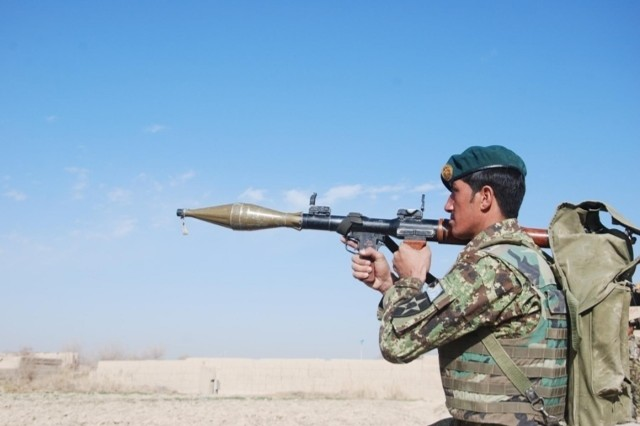 A soldier from the Afghan National Army provides security during Operation Chamtoo, December 2013. Afghan National Security Forces conducted the operation across four provinces in southern Afghanistan simultaneously, discovering weapons and improvised explosive devices while clearing areas of insurgents.