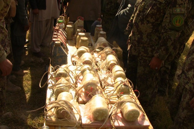 Disarmed improvised explosive devices are stacked after being discovered by Afghan National Security Forces during Operation Chamtoo, December 2013. Afghan National Security Forces conducted the operation across four provinces in southern Afghanistan simultaneously, discovering weapons and improvised explosive devices while clearing areas of insurgents.