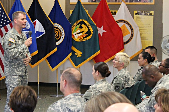 Brig. Gen. Ted C. Harrison, commanding general Army Contracting Command, talks about the command during a town hall session with ACC-Rock Island (Ill.) employees.