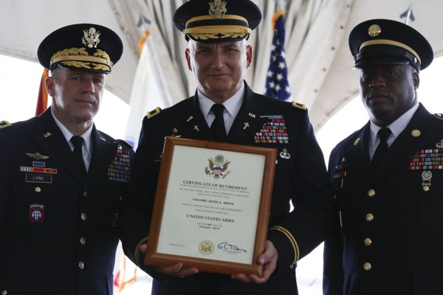 Col. Dave Neetz (center), the retiring 8th Theater Sustainment Command's chaplain, holds up his Certificate of Retirement with Maj. Gen. Stephen R. Lyons (left), the commanding general of the 8th TSC, and Sgt. Maj. Davis, the former noncommissioned officer in charge of the chaplain section for the 8th TSC, during his retirement ceremony, Nov. 6, 2013, at the Hale Ikena on Fort Shafter, Hawaii. (U.S. Army photo by Sgt. Jesse Untalan, 8th Theater Sustainment Command Public Affairs)