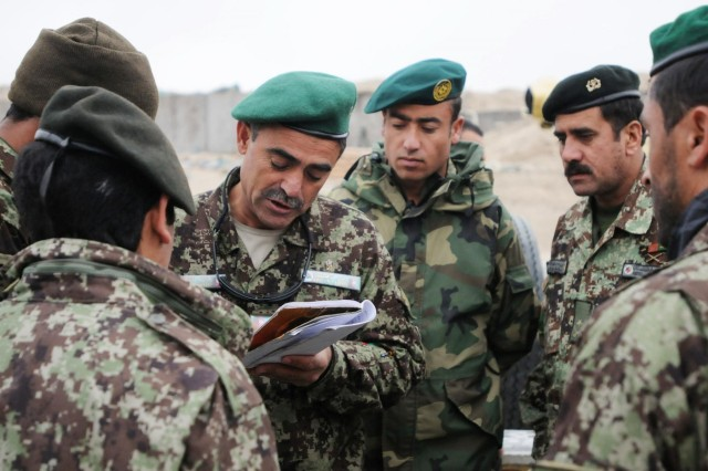Afghan Col. Ahmad Jan, fires support officer with the 201st Afghan National Army Corps instructs 1st Brigade, 201st ANA Corps soldiers on the day's D-30 artillery refresher training at Forward Operating Base Mehtar Lam, Jan. 8, 2014. ANA Artillery officers are at a stage of leading much of their own training. D-30 trainers with 5th Battalion, 25th Field Artillery Regiment have moved to a position of observing the training and no longer instructing. (U.S. Army Photo by Sgt. 1st Class E. L. Craig)