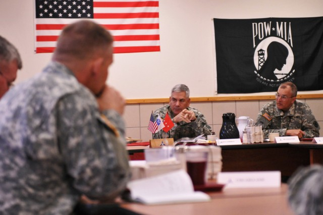 Gen. John Campbell (center), vice chief of staff of the Army, has breakfast with senior commanders in the Freeman Dining Facility at Fort Hood, Texas, Jan. 6, 2014.