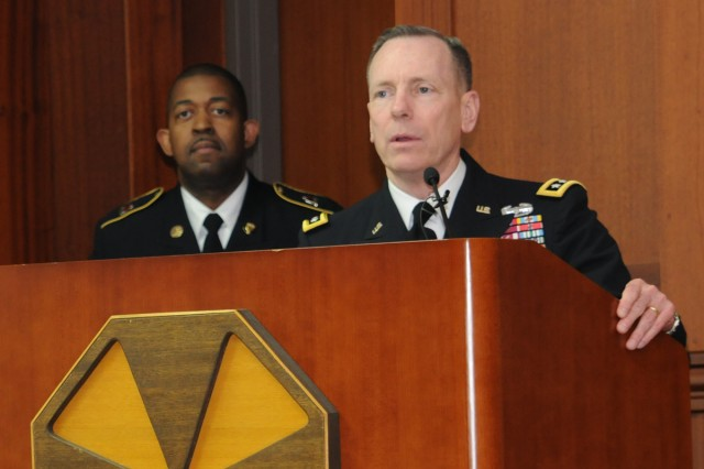 Eighth Army Commanding General Lt. Gen. Bernard S. Champoux (right) speaks at the Combined Logistics Excellence Award Ceremony on Yongsan Garrison, South Korea, Jan 16, 2014.