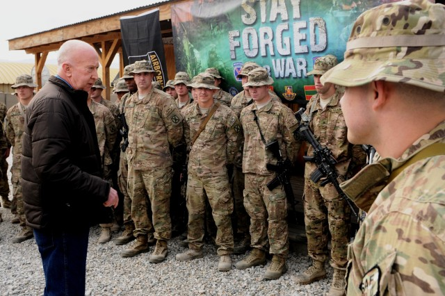 """LAGHMAN PROVINCE, Afghanistan """" Medal of Honor recipient Don Jenkins imparts some words of wisdom to the Soldiers of 4th Brigade Combat Team, 10th Mountain Division, Task Force Patriot, at Forward Operating Base Gamberi while visiting there Jan. 13, 2014, with fellow MoH recipient Walter Marm Jr. and actor Stephen Lang. The three also brought a gift to the troops, Lang performed excerpts from his play """"Beyond Glory"""", a one man show telling the stories of a few men who have received America's highest military decoration, including Marm and Jenkins. (U.S. Army Photo by Sgt. Eric Provost, Task Force Patriot PAO)"""