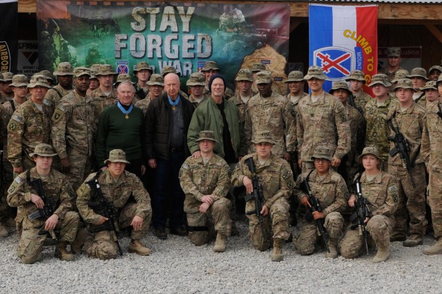 """LAGHMAN PROVINCE, Afghanistan """" Medal of Honor recipients Walter Marm Jr. (center left) and Don Jenkins (center), along with actor Stephen Lang (center right), join Soldiers and leaders at Forward Operating Base Gamberi for a group photo during their visit to the base Jan. 13, 2014. The three travelled to locations across Afghanistan to meet the Soldiers of this generation and bring them a performance of Beyond Glory, a production written by and starring Lang about the stories of some of America's greatest military heroes, Marm and Jenkins being among them. (U.S. Army Photo by Sgt. Eric Provost, Task Force Patriot PAO)"""