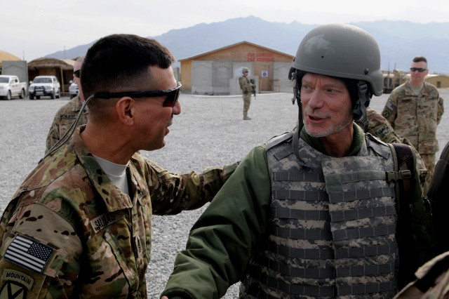 """LAGHMAN PROVINCE, Afghanistan """" U.S. Army Command Sgt. Maj. Noe Salinas, senior enlisted leader, 4th Brigade Combat Team, 10th Mountain Division, Task Force Patriot, gives one last thank you to actor Stephen Lang for coming to perform for the troops at Forward Operating Base Gamberi Jan. 13, 2014, as he prepares to depart the base. Lang performed excerpts from his show Beyond Glory, a collection of stories inspired by Medal of Honor recipients, and was joined at Gamberi by two of them, medal recipients Walter Marm Jr. and Don Jenkins, who took time to meet with the Soldiers and impart some words of wisdom to the new generation. (U.S. Army Photo by Sgt. Eric Provost, Task Force Patriot PAO)"""