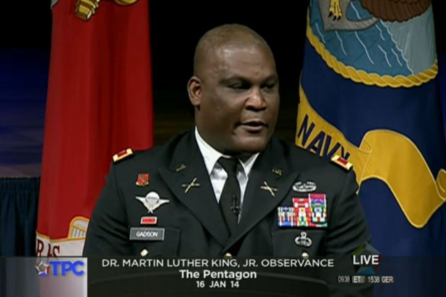 Army Col. Greg Gadson, garrison commander of Fort Belvoir, Va.provides the keynote address during the Pentagon's annual commemoration of the life of Martin Luther King Jr. held in the Pentagon auditorium 16 Jan., 2014. On May 7, 2007, Gadson was returning from a memorial service for two fellow soldiers when he was struck by a roadside bomb. Gadson lost both legs and suffered serious injury to his right arm.