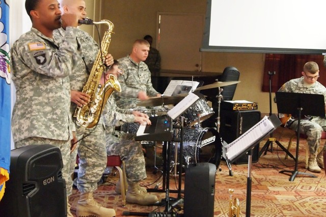 "From left, Military Intelligence Corps Band members Staff Sgt. Dnard Edwards, Sgt. Jamie Jones, Sgt. Christopher Goodman, Sgt. Stephen Brinkman and Spc. Johnanthony Demaio perform a musical selection during the Dr. Martin Luther King Jr. Observance Tuesday at Thunder Mountain Activity Centre. Earlier in the ceremony, the band also performed ""We Shall Overcome."""