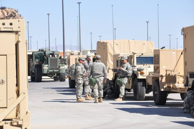 Soldiers from the 2nd Special Troops Battalion prepare their equipment and vehicles for convoy operations for the Network Integration Exercise. (photo from 2nd Brigade, 1st Armored Division Facebook Page)