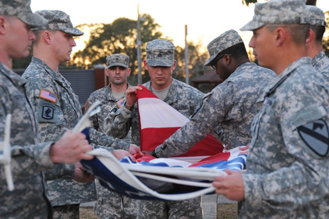 Soldiers from the NCO Academy fold the flag during the 'Retreat' ceremony on Howze Field Jan. 14.