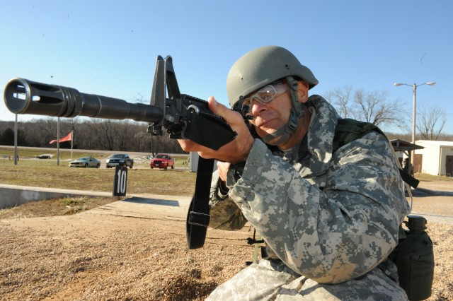 Sgt. Steven Lyzenga adjusts his aim while training on the firing range with Company A, 3rd Battalion, 10th Infantry BCT. Lyzenga went from being an Air Force pilot to Army BCT.  Story and photo by Melissa Buckley