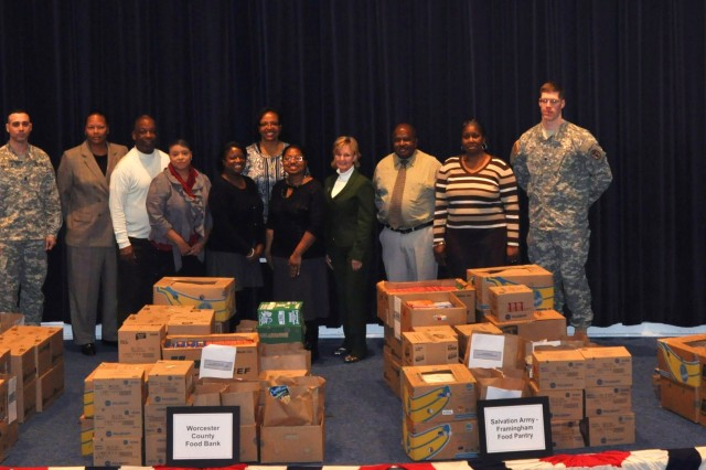 Members of the Black Employment Program Committee stand among more than 6,000 pounds of donations they received Jan. 15. The food and supply drive was held for one week and gained contributions from the personnel of the Natick Soldier Systems Center, as well as the Hanscom Air Force Base Commissary.