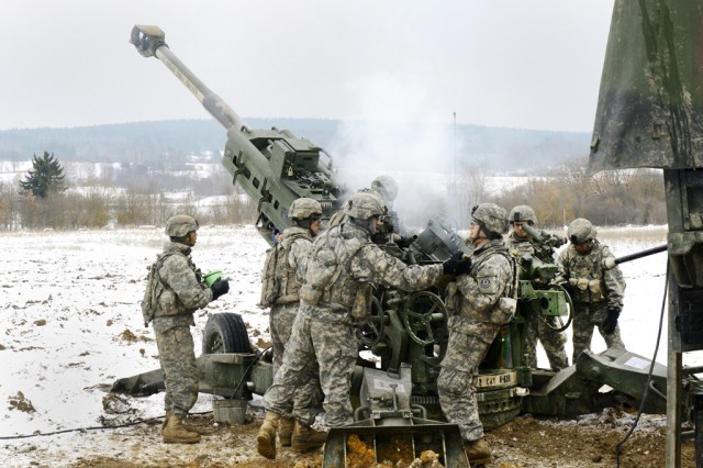 Soldiers assigned to Bulldog Battery, Field Artillery Squadron, 2nd Cavalry Regiment, load a M777A2 Howitzer during 2nd Cavalry Regiment's Maneuver Rehearsal Exercise at Grafenwoehr Training Area, Germany, Feb. 13, 2013. The U.S. Army is nearing completion on a project to eliminate its dependency on foreign countries for a critical energetic component in artillery and mortar ammunition.