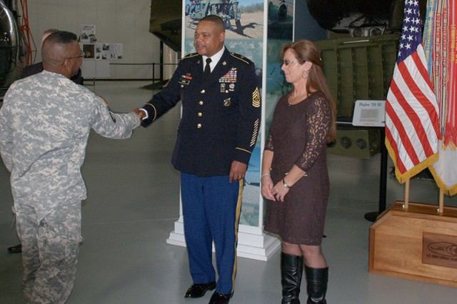 Command Sergeant Major Leeford C. Cain and his wife, Jutta, receive guests after the change of responsibility ceremony here, Friday. Cain was installed at the Army's top enlisted adviser on safety issues after assuming duties from Command Sgt. Maj. Richard D. Stidley. U.S. Army photo by Danny Clemmons
