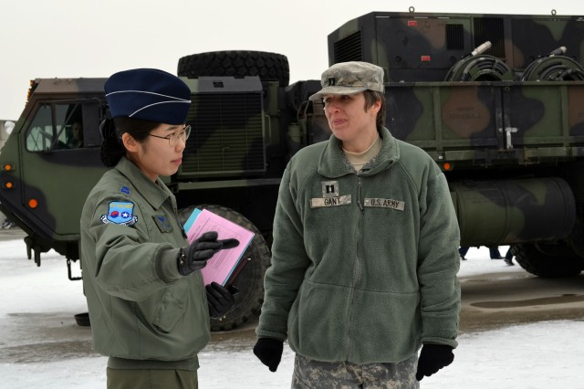 Capt. Christine Gant, the 35th Air Defense Artillery Brigade fire coordination officer, speaks with Republic of Korea Air Force Academy Maj. Park, Min-kyung about the U.S. Patriot missile system during a visit January 21, 2014. Nearly 100 cadets attended the trip to learn about the U.S. Patriot missile and Army air defense. (Photo by: U.S. Army Staff Sgt. Heather A. Denby, 35th ADA Public Affairs)