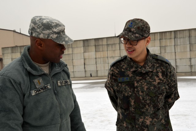 2nd Lt. James Chambers, an air defense platoon leader, speaks with a Republic of Korea Air Force Academy translator during the academy's visit January 21, 2014. Nearly 100 cadets attended the trip to learn about the U.S. Patriot missile and Army air defense. (Photo by: U.S. Army Staff Sgt. Heather A. Denby, 35th ADA Public Affairs)