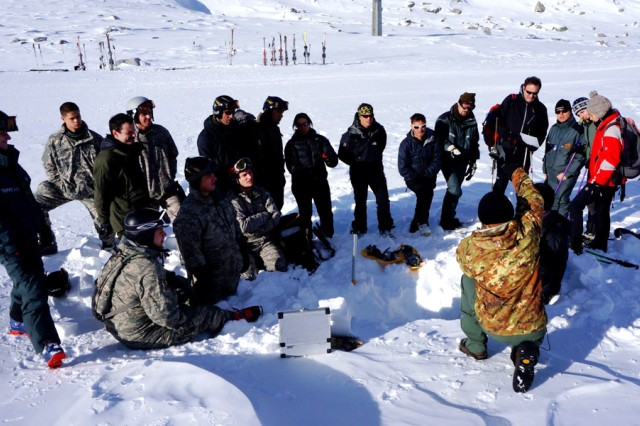 "Airmen from the U.S. Air Force 7th Weather Squadron learn to calculate snow conditions with Alpini instructors and soldiers of the Italian Truppe Alpini""Servizio Meteomont during annual partnership training at Passo Tonale, Italy, in December."