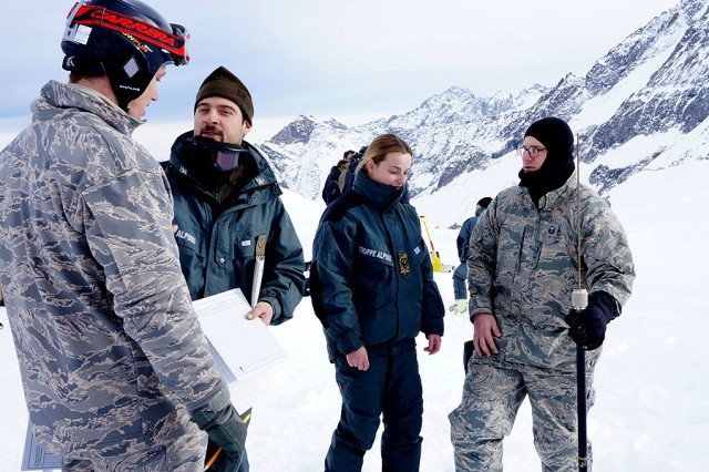 "Master Sgt. Kevin Goff (left), Detachment 3, 7th Weather Squadron, based in Vicenza, and Master Sgt. Timothy Legg of the squadron's headquarters, based in Wiesbaden, Germany, work with instructors from the Italian Truppe Alpini""Servizio Meteomont to calculate snow conditions during annual partnership training at Passo Tonale, Italy, in December."