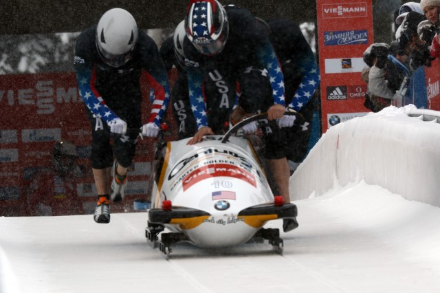 Sgt. Nick Cunningham of the U.S. Army World Class Athlete Program jumps into the sled to drive Olympic gold medalist and WCAP teammate Sgt. Justin Olsen, Johnny Quinn and Abe Morlu to 16th place in the four-man bobsled event at the International Bobsled & Skeleton Federation's 2013 World Cup stop, Dec. 7, 2013, at Utah Olympic Park in Park City, Utah.