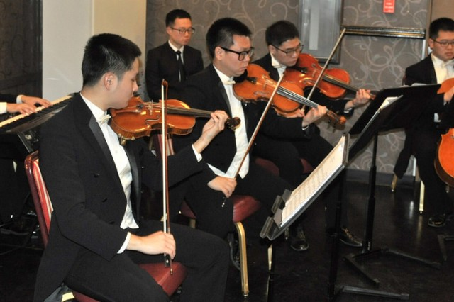 Members of the Republic of Korea's Ministry of National Defense Orchestra perform during the New Year's reception, held at the R&R Bar and Grill. Many guests enjoyed food, music, and the pleasurable mood. (U.S. Army photo by Cpl. Jung Jihoon)