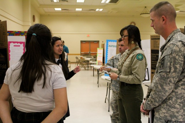 Army trainers judge fourth annual local science fair projects