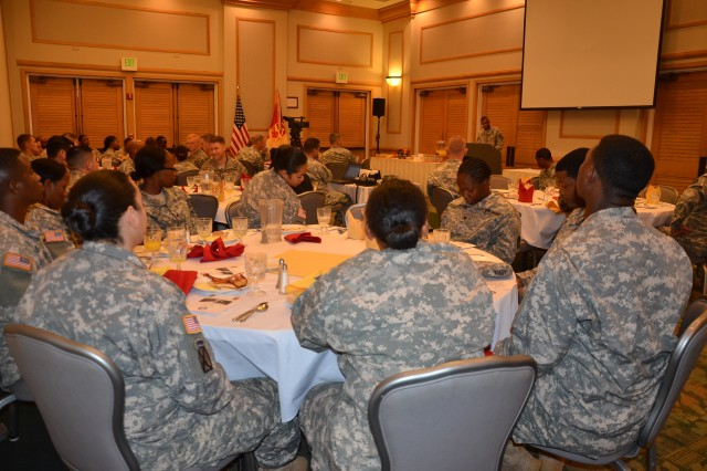 94th AAMDC Soldiers enjoy bacon and eggs at the unit's quarterly prayer breakfast at the Hale Ikena Hotel on Fort Shafter, Jan. 15, as they listen to CH Ken Revell talk about the impact Dr. Martin Luther King Jr. had on the civil rights movement in the 60's and how applying King's message could impact our lives today.