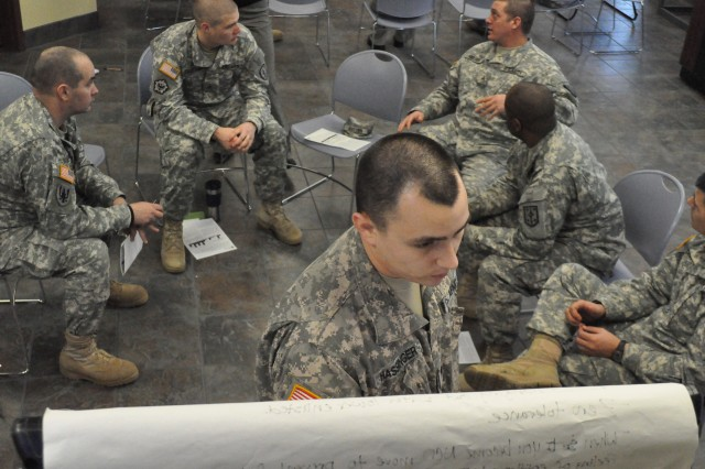 Sgt. Preston Hassinger writes down points made during a discussion at the 4th MEB's Jan. 16 seminar focusing on readiness and resilience at Fort Leonard Wood, Mo.