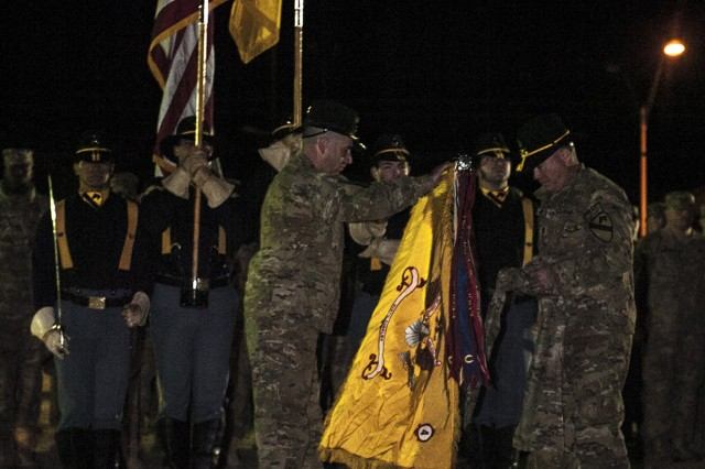 Lt. Col. Robert Smith (left), commander of the 4th Squadron, 9th Cavalry Regiment, 2nd Brigade Combat Team, 1st Cavalry Division, and Command Sgt. Maj. Michael Moser (right), senior enlisted advisor of the 4th Sqdn., 9th Cav. Regt., uncase the battalion colors during a welcome home ceremony on Cooper Field at Fort Hood, Texas, Jan. 22. Elements of the 2nd BCT will continue to return to Fort Hood over the next few months as they complete their mission in Afghanistan. (U.S. Army photo by Sgt. Angel Turner, 1st Cav. Div. PAO (Released)