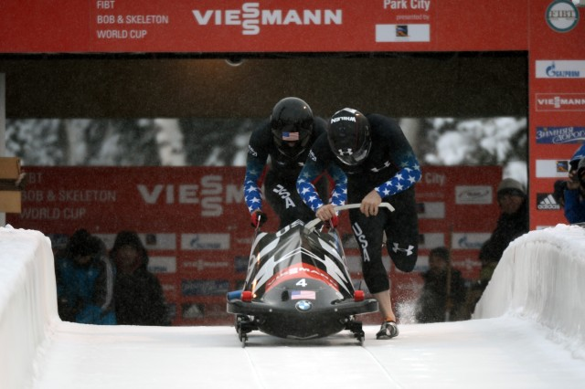 Former U.S. Army World Class Athlete Program and reigning Olympic bobsled champion driver Steven Holcomb (right) and WCAP Olympian Capt. Chris Fogt start their first run en route to winning the two-man bobsled event Dec. 6 at the 2013 International Bobsled & Skeleton Federation World Cup stop at Utah Olympic Park in Park City, Utah.