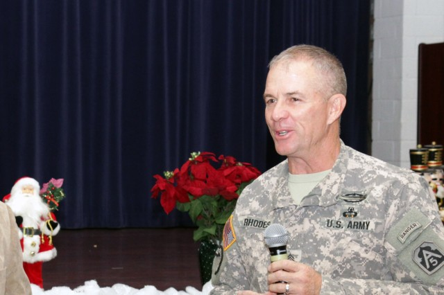 Command Sgt. Maj. Hu Rhodes, U.S. Army North and senior enlisted adviser for Fort Sam Houston, Texas, and Camp Bullis, addresses the audience, Dec 12, 2013, following a leadership discussion. Rhodes said he believes commitment is something expected of all Soldiers, not just those in leadership positions.