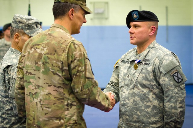 Maj. Gen. Stephen J. Townsend, Fort Drum and 10th Mountain Division (LI) commander, thanks Sgt. Roy Arcentales, 1st Battalion, 87th Infantry Regiment, 1st Brigade Combat Team, for his selfless actions while attempting to save a fellow Soldier's life during their recent deployment to eastern Afghanistan. He and Sgt. Caleb Walters, also from 1-87 Infantry, were awarded the highest honor for valor in a noncombat situation during a ceremony Thursday at Monti Physical Fitness Center on Fort Drum.