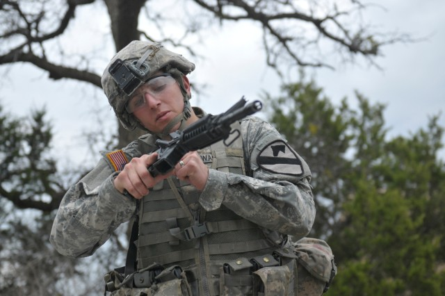 Spc. Chad Wagner, a Silver Grove, Ky., native with the 3rd Battalion, 8th Cavalry Regiment, 3rd Brigade Combat Team, 1st Cavalry Division, checks the chamber of an M4 carbine to see if it is loaded, Jan. 10, at Fort Hood, Texas. Wagner disassembled, reassembled and performed a functions check on different weapons while being evaluated in the Soldier of the Quarter competition. (U.S. Army photo by Spc. Brandon Banzhaf, 3rd BCT PAO, 1st Cav. Div.)