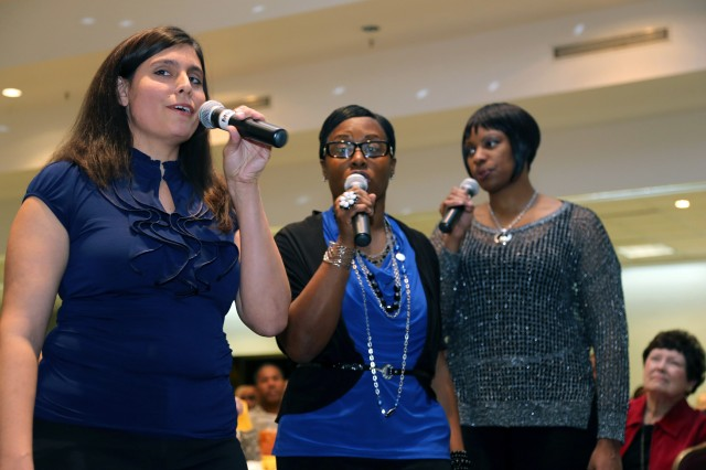 "Angela Kempe, Pamela Lingford and Arnetra Hughes sing ""Something Inside so Strong"" as part of the entertainment during the Fort Sill Dr. Martin Luther King Jr. commemoration Jan. 16, 2013, at the Patriot Club. Soldiers and family members from the 75th Fires Brigade provided much of the entertainment for the event."