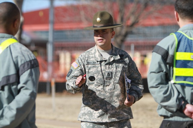 Sgt. 1st Class Victor Marquez, Fort Sill 2012 Drill Sergeant of the Year, gives feedback to a drill sergeant candidate after he taught a module of training Jan. 17. He told the Soldiers to be confident going to Drill Sergeant School because they are more preapred after taking the Drill Sergeant Candidate course.