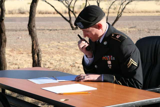 On the last day of the 2013 Best Warrior Competition, Cpl. Isaac Milam, 305th Military Intelligence Battalion and competitor, conducts a mock call for a medical evaluation of an injured comrade, a task required for the mystery event.