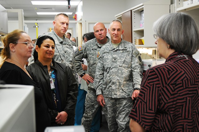 Col. Stuart J. McRae, Fort Rucker garrison commander, Command Sgt. Maj. Buford E. Noland, garrison command sergeant major, and Col. James A. Laterza, Lyster Army Health Clinic commander, take a tour of the new laboratory at Lyster after the ribbon cutting ceremony to open the facility Jan. 15.