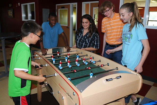 Teens play a game of foosball last year at the Fort Rucker Youth Center. The center will hold a Get a Clue Party for registered members with active passes, ages 11-18, and their guests Jan. 24 from 4-8 p.m.