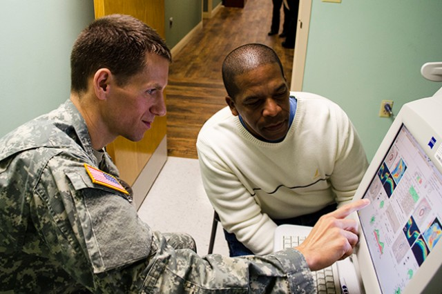 Capt. Bret Lehman, optometrist at Lyster Army Health Clinic, on Fort Rucker, Ala., reviews glaucoma reading results with Sgt. 1st Class Jorge Camarafalu during a routine eye exam Jan. 17, 2014.