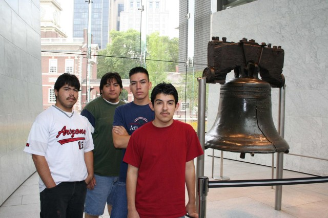 Army Sgt. Oscar Vazquez, a cavalry scout with the 1st Squadron, 40th Cavalry Regiment, 4th Infantry Brigade Combat Team (Airborne), 25th Infantry Division (3rd from left), poses for a picture beside the Liberty Bell with his robotics competition team during the summer of 2005 in Philadelphia, Pa. The team won a nationally-recognized competition for the underwater remotely operated vehicle they designed and built. The team from Carl Hayden Community High School in Phoenix is pictured (from left), Lorenzo Santillan, Luis Aranda, Oscar Vazquez, and Christian Arcega. (Courtesy Photo)